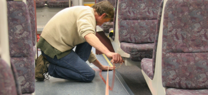 Firefly photo luminescent tape applied to bus floor - INPS