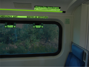 Photo luminescent markers on train window - Firefly Glow